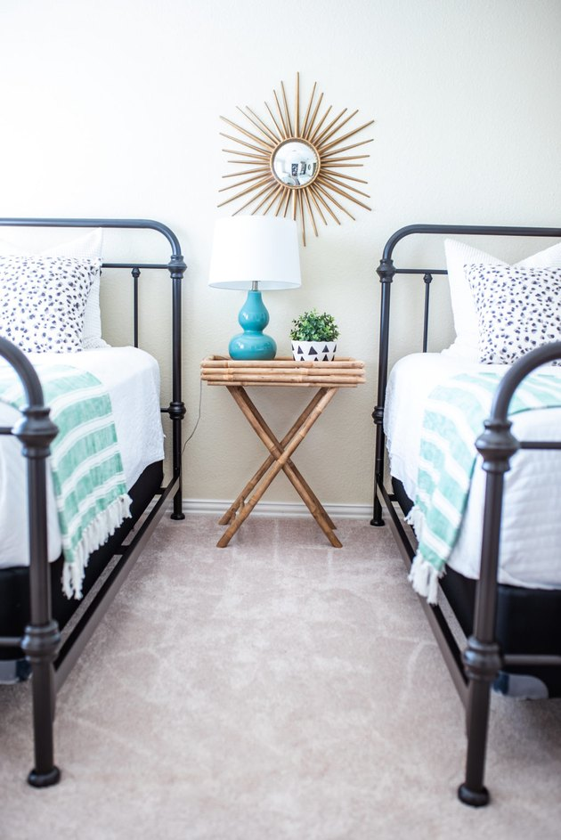 guest bedroom decorating idea with two metal frame beds
