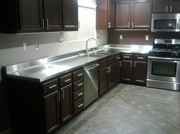 Kitchen with stainless steel countertops.