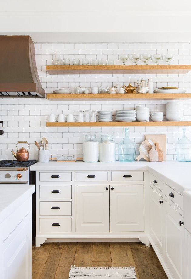 small kitchen idea with open shelving in unfinished light stained wood and glassware
