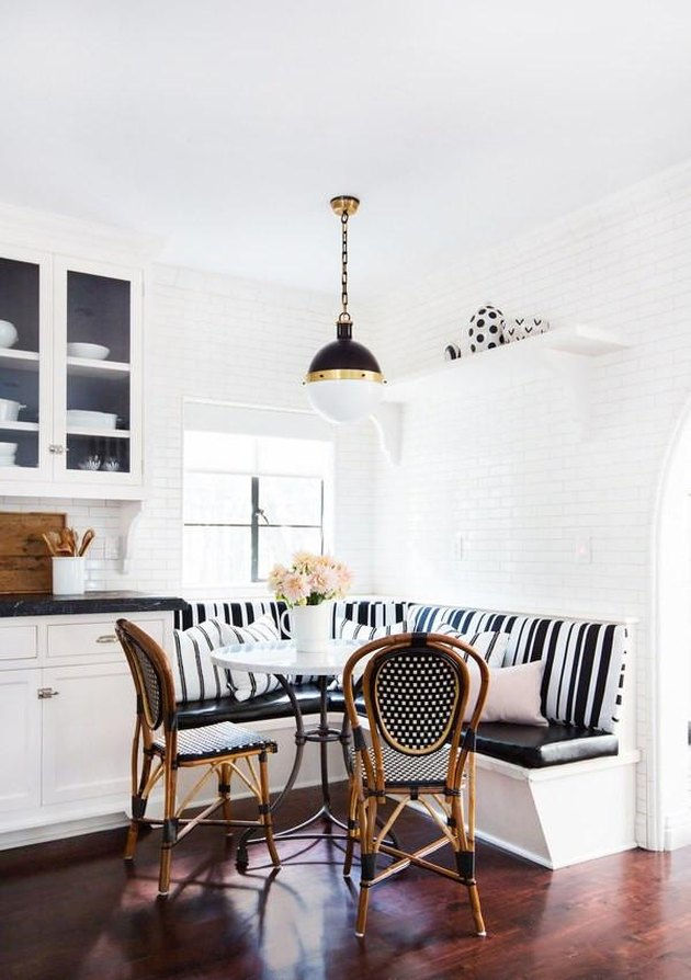 small kitchen idea with breakfast nook and woven rattan Parisian-style bistro chairs