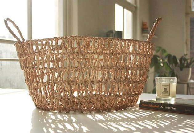 Small loosely woven oval basket with handles
