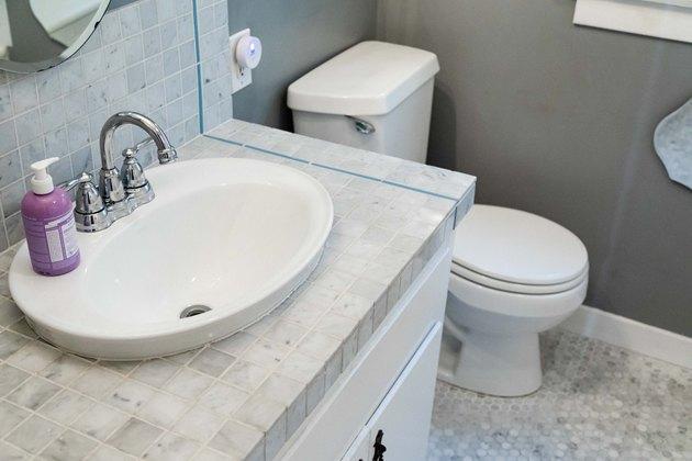 bathroom toilet, bathroom vanity cabinet and sink