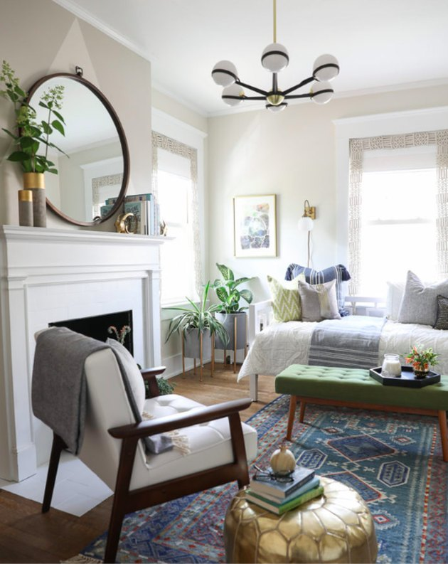 guest bedroom decorating idea with fireplace and lounge chair