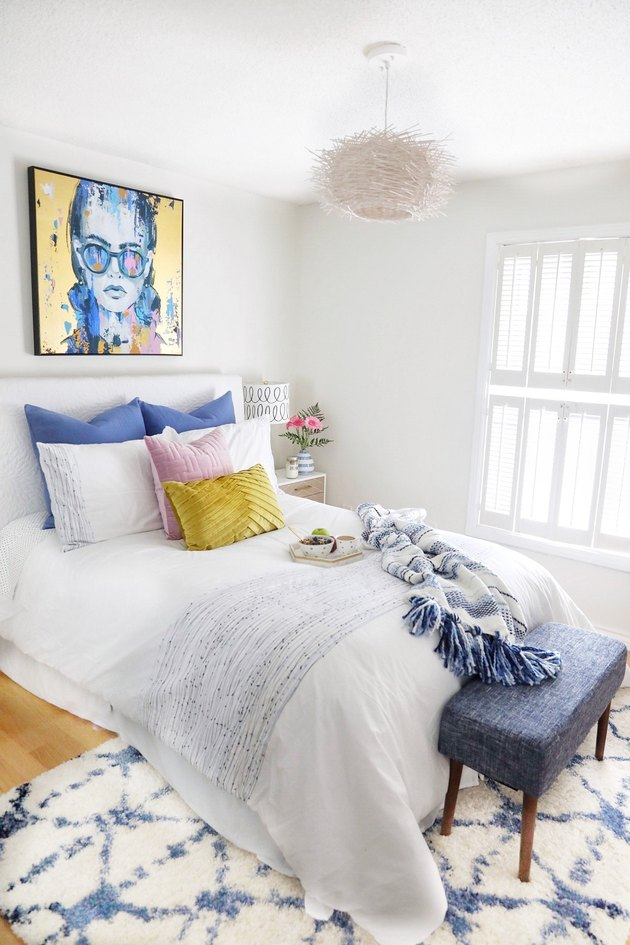 white guest bedroom decorating idea with accent bench and pendant light