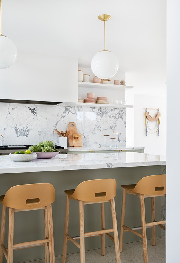 small kitchen idea with tall marble backsplash and open shelving