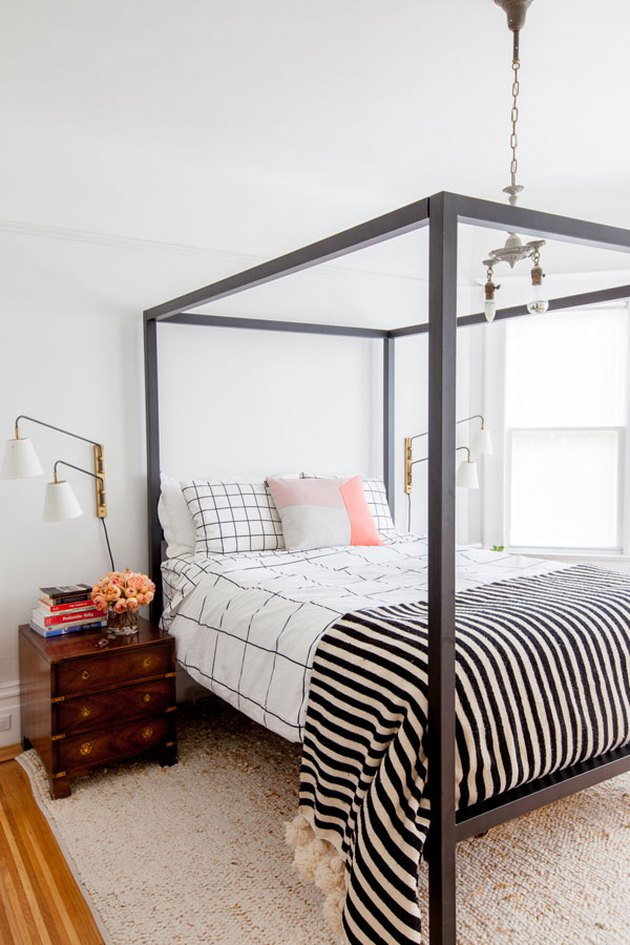 guest bedroom decorating idea with four poster canopy bed and patterned bedding