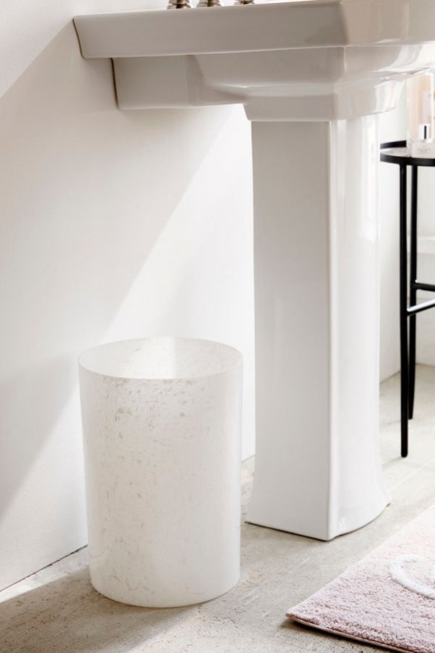 small marble bathroom trash can