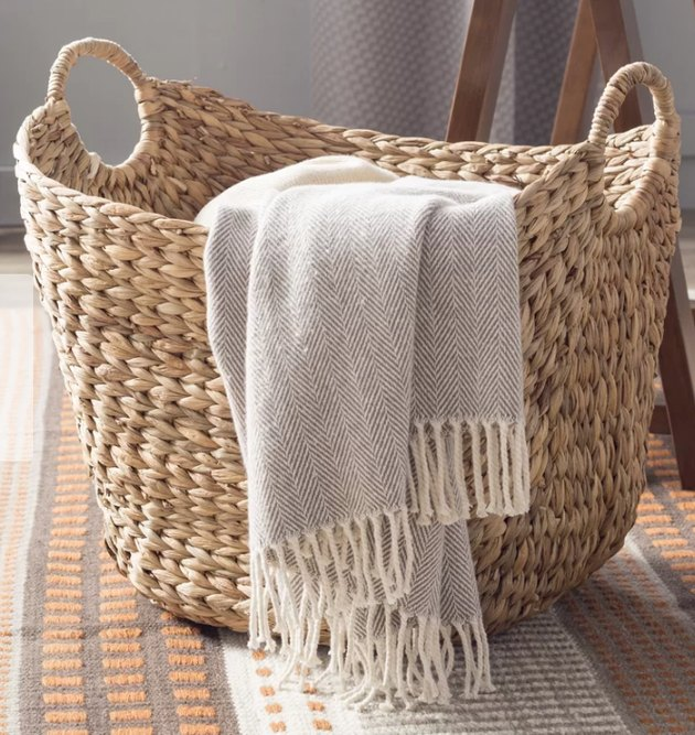 tall wicker basket with handles
