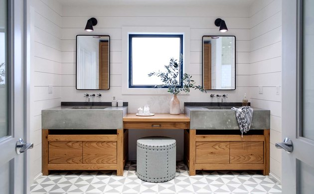 bathroom makeup vanity between double concrete sinks