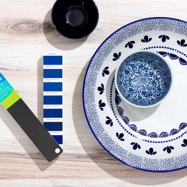 pantone color swatch next to dinnerware