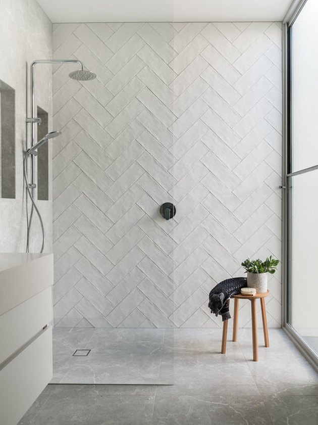 subway tile shower idea in herringbone pattern