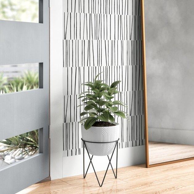 textured concrete planter on modern metal stand