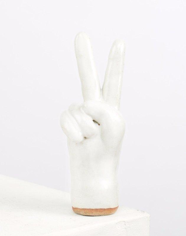 White ceramic peace sign.