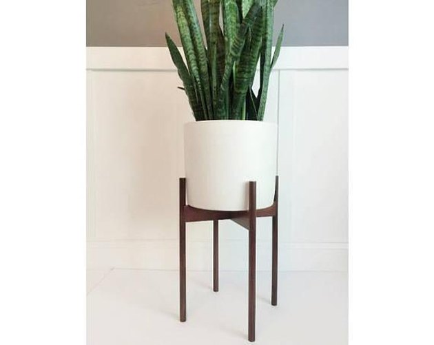 Walnut mid-century plant stand with white cylinder planter