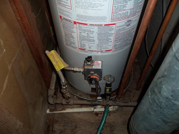 Draining a water heater.