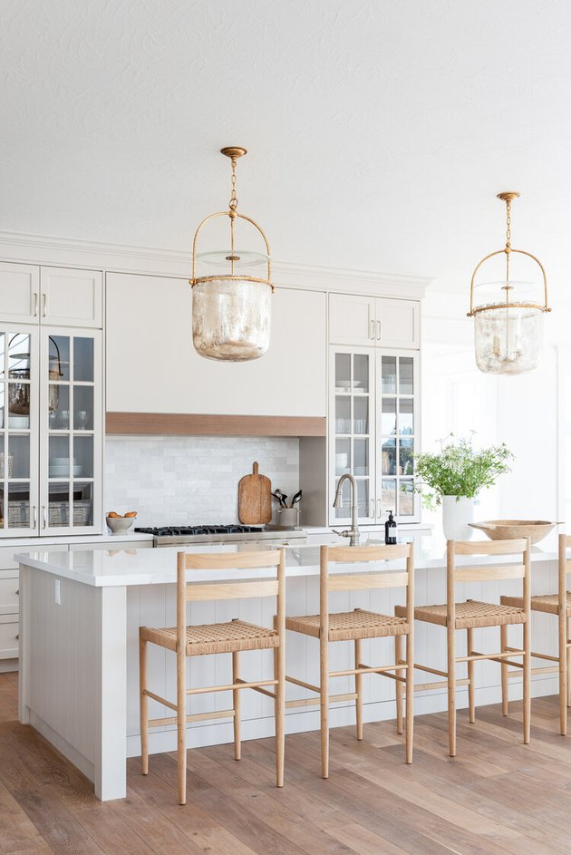 neutral kitchen with tall kitchen cabinets with glass fronts