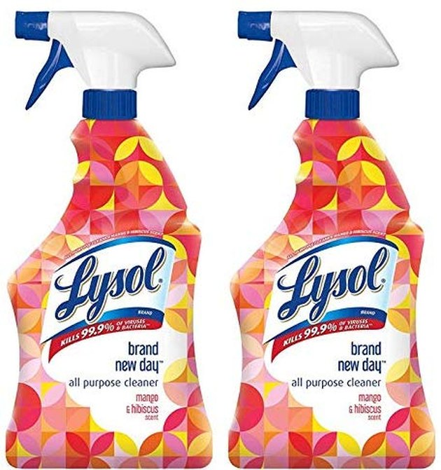 two bottles of lysol spray with colorful packaging