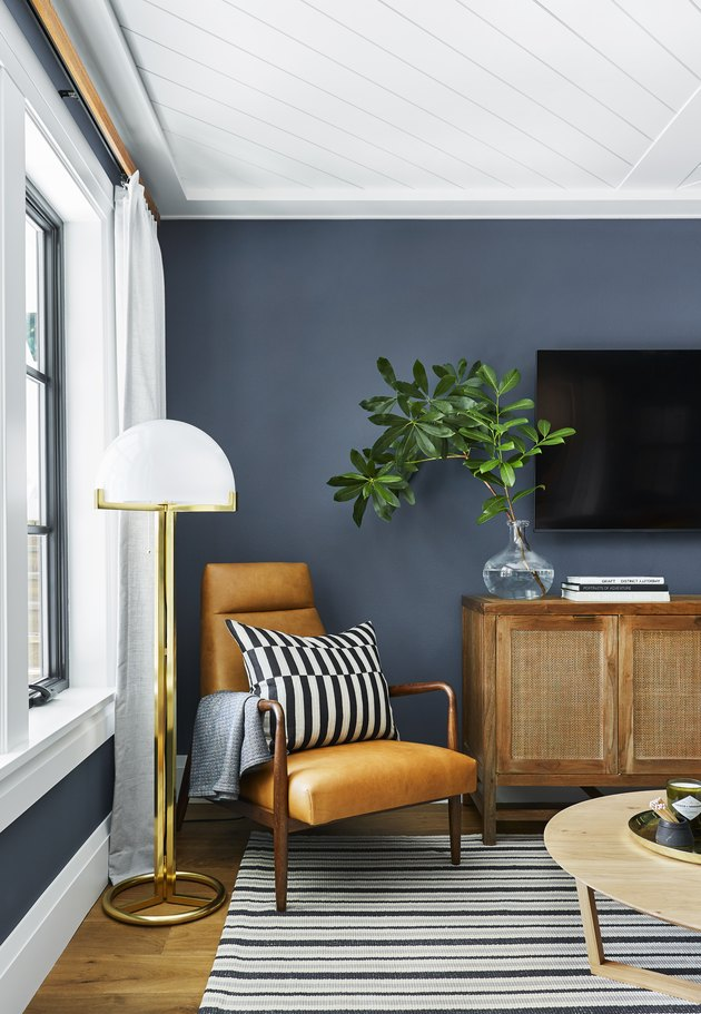Navy blue family room paint colors with leather chair.