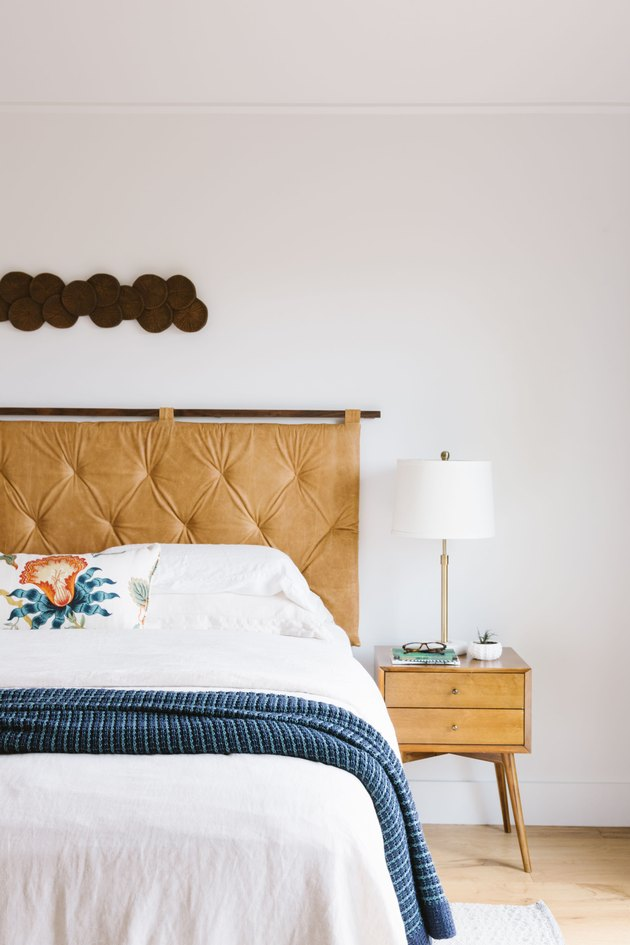 Vintage bedroom idea with upholstered headboard
