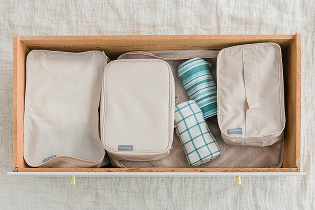 Use packing cubes in your drawers exactly as you would a suitcase!