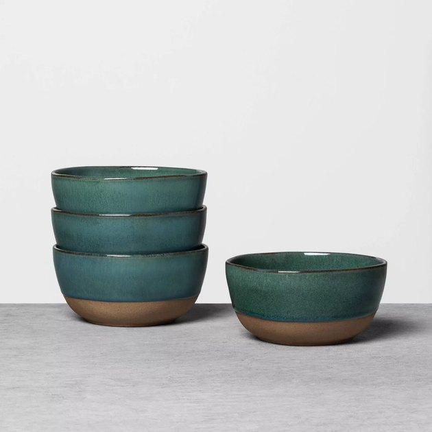 stack of three green bowls with one green bowl next to it