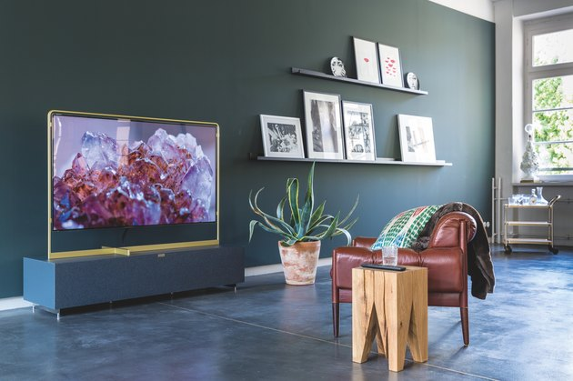 Green family room paint colors with leather accent chair