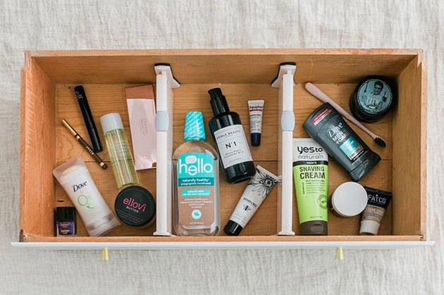 "Divide daily toiletries into ""His,"" ""Hers,"" and ""Theirs"" collections using dividers."