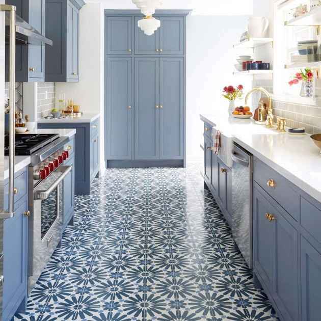 art deco apartment with blue kitchen with blue and white tiles