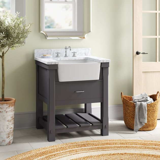 Slate gray country bathroom vanity with apron front sink and Carrara marble top