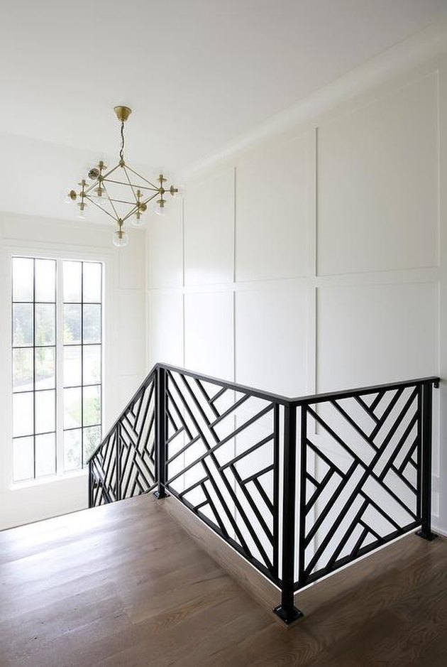 geometric pattern modern stair railing with gold ceiling light