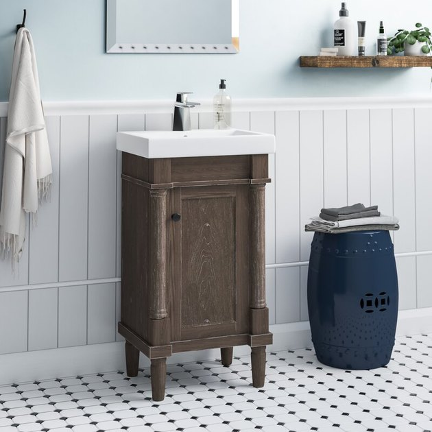 Small wood country bathroom vanity with cabinet and white porcelain sink