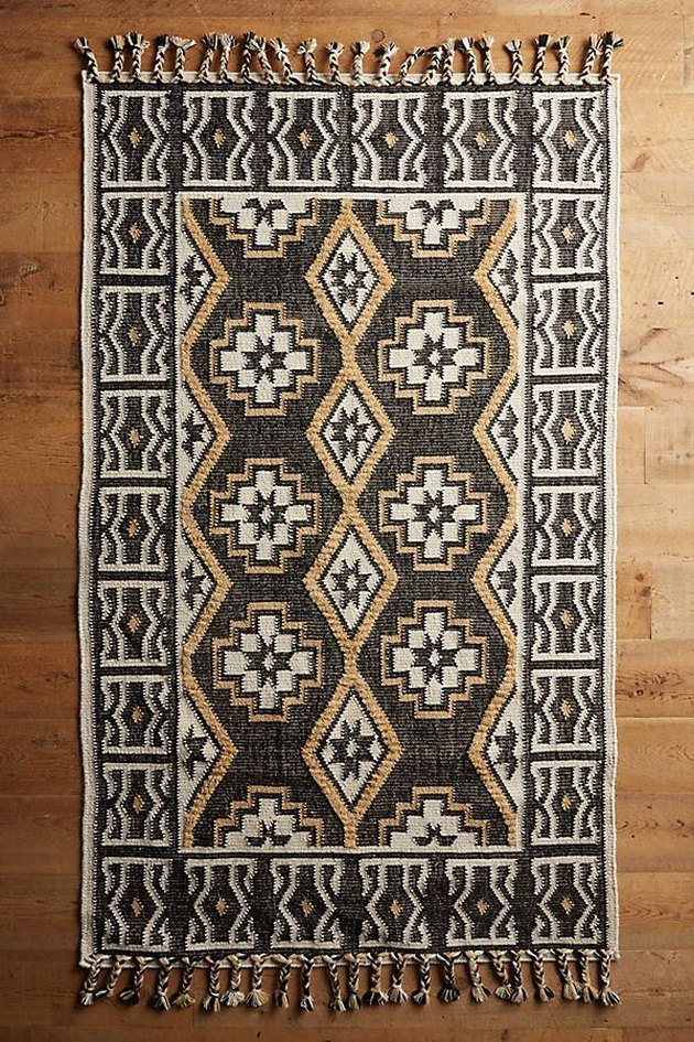 Gray, beige, and pale yellow geometric rug with fringe