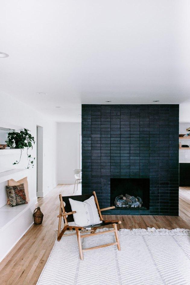 Scandinavian fireplace idea with black brick tile