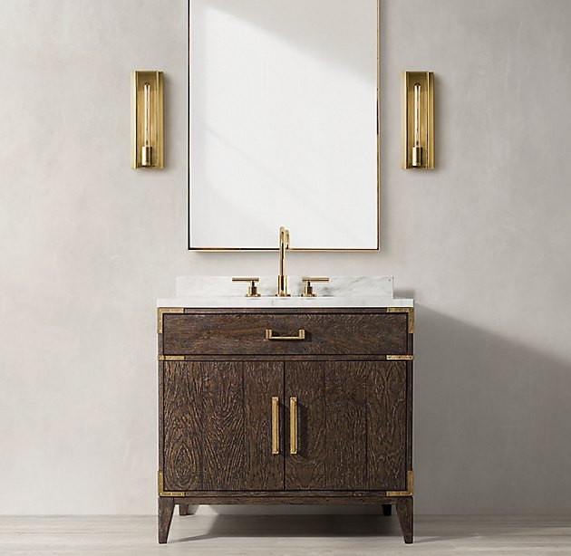 Wood country bathroom vanity with brass hardware in modern space