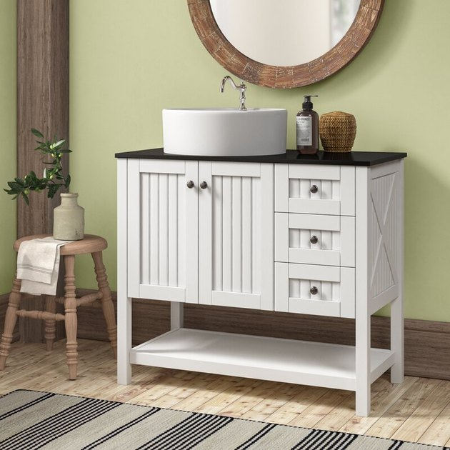 White shiplap country bathroom vanity with cabinets and drawers in green bathroom