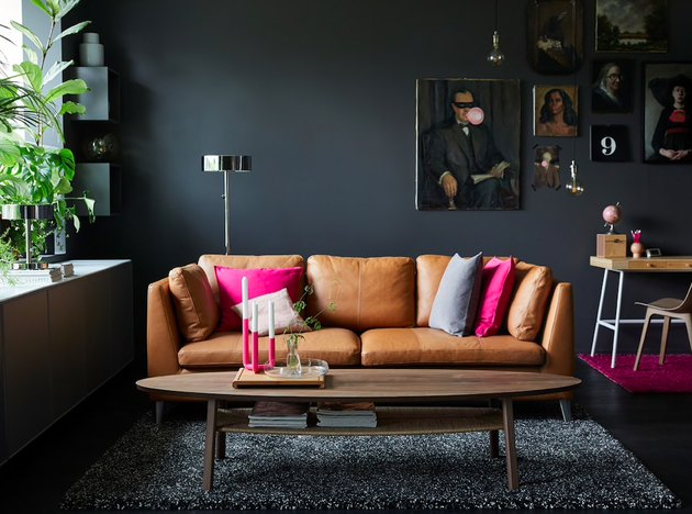 black living room with gallery wall and leather sofa