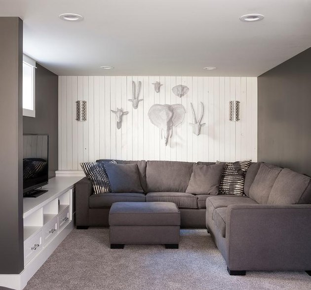 family room wall ideas with paper mache animal heads