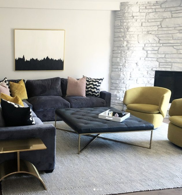 modern family room ideas with yellow swivel chairs and upholstered coffee table