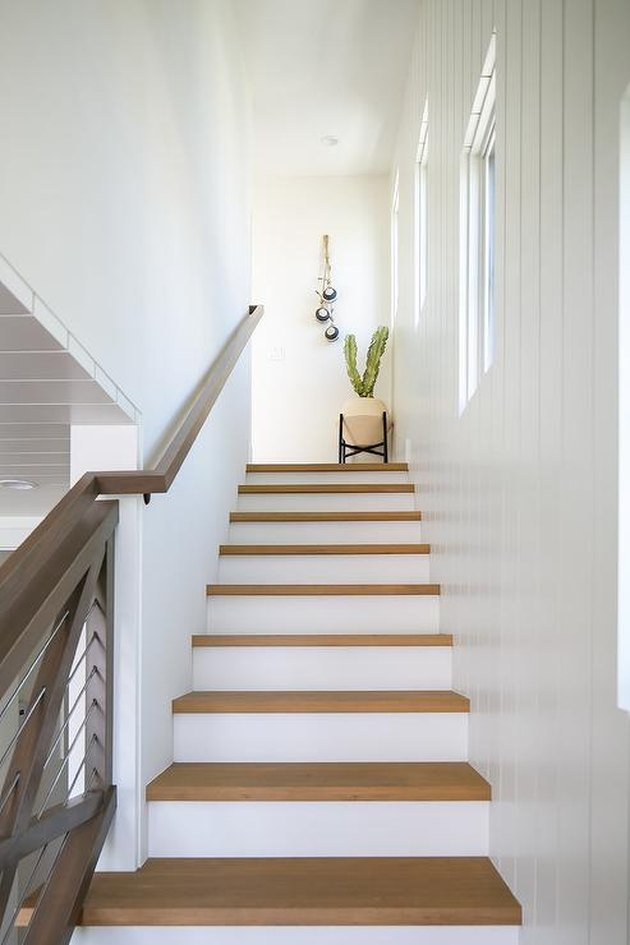 wood and white modern stair railing with cactus