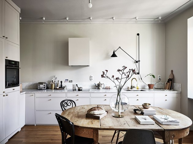 Scandinavian farmhouse style kitchen with vintage table and chairs