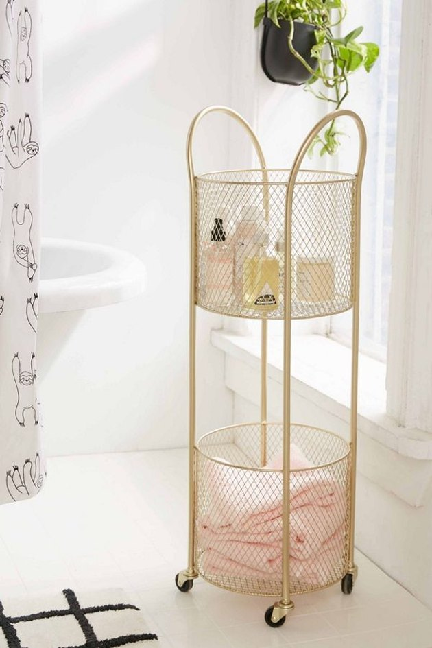 small bathroom storage ideas with  rollable gold metal storage cart