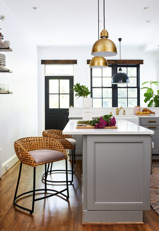 kitchen island ideas for small kitchens with brass pendant lights and wicker chairs