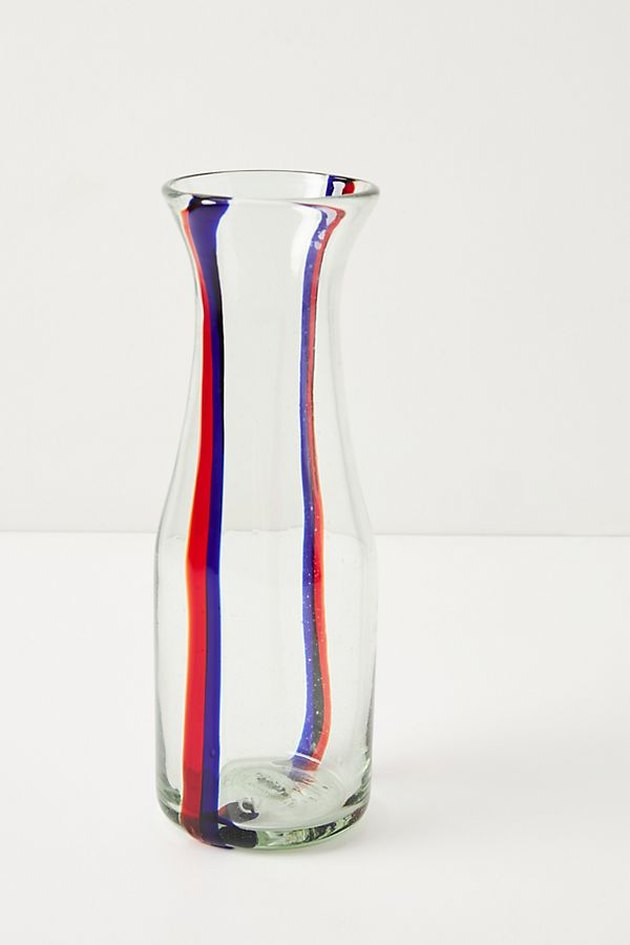 glass carafe with blue and red stripes