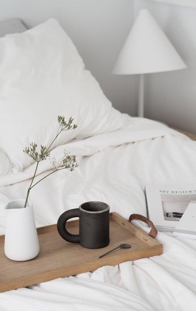 white minimalist bedroom idea with warm details