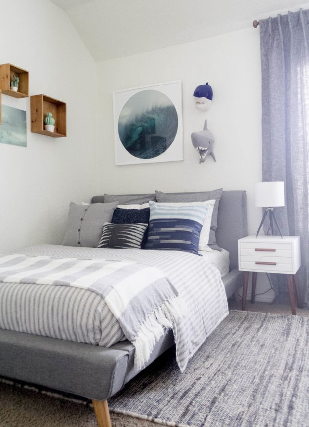 Kids' minimalist bedroom with ocean decor and striped bedding