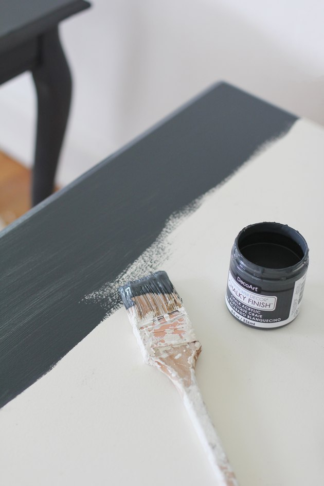 white tabletop being painted with chalky finish chalk paint