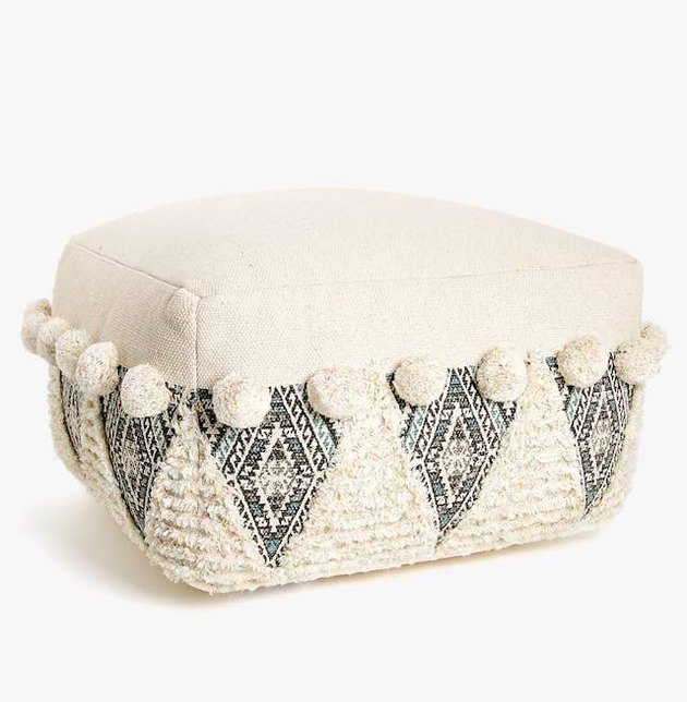 ivory wool pouf with bobbles