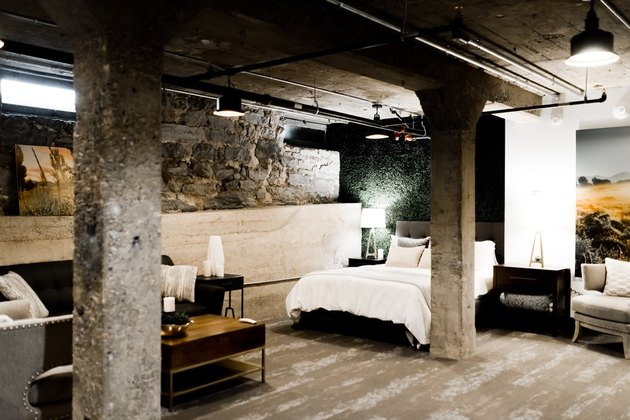 basement family room ideas with exposed rock and dual bedroom