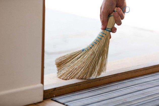Hand broom sweeping floor