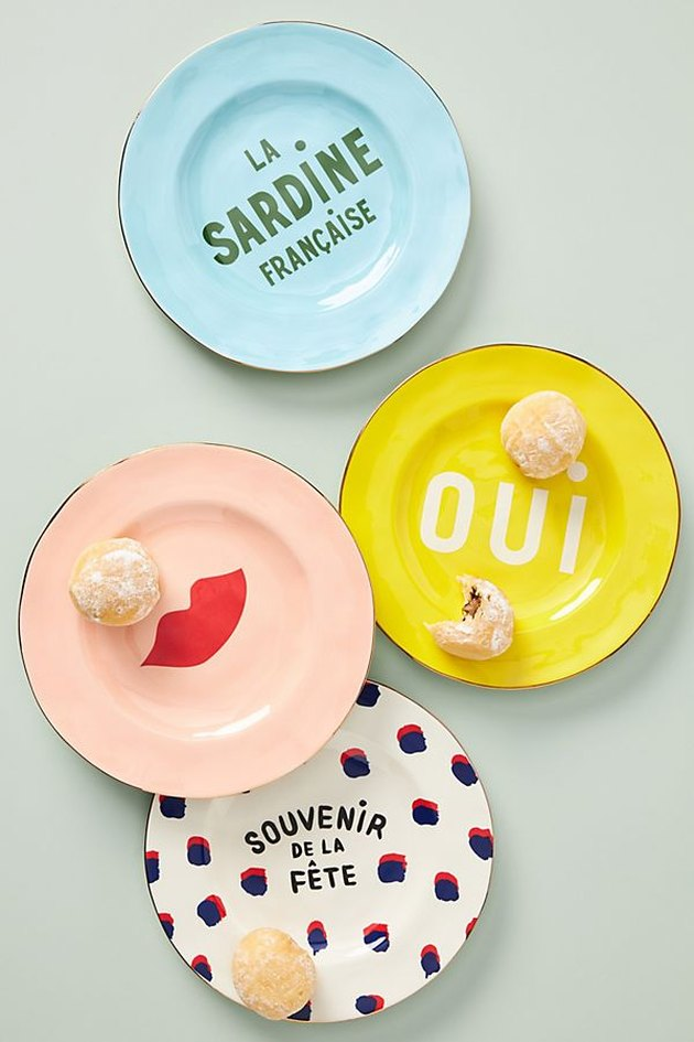 four colorful plates with french text